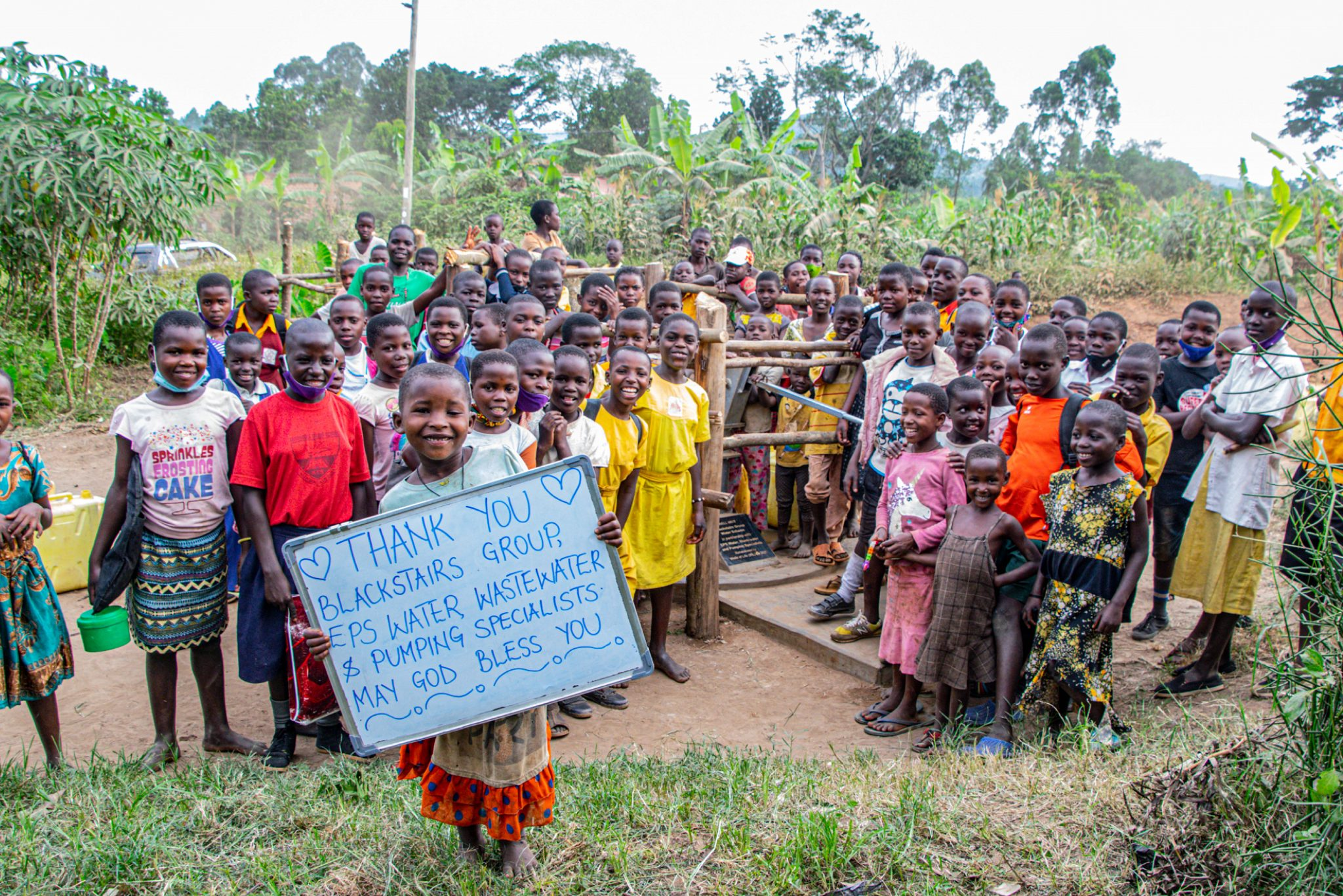 Happy smiling faces as EPS restores water well in Uganda